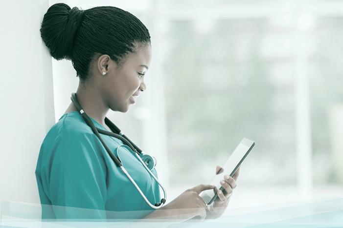 Nurses-Infromatics-using-a-tablet.jpg